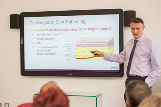 surgeon Miles G Berry presenting a lecture on skin tightening